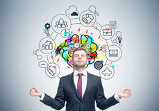 Meditating businessman, brain and gears Stock Images