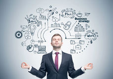 Meditating businessman, business strategy Stock Images