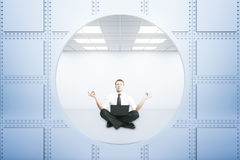 Meditating businessman Stock Images