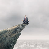 Meditating businessman Stock Photos