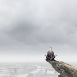 Meditating businessman Royalty Free Stock Images