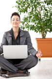 Meditating Businesswoman With Laptop Royalty Free Stock Photo