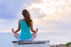 Meditating in a calm environment Stock Photos