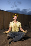 Meditating Construction Worker Stock Images