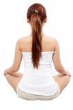 Meditating della donna catturato da dietro Immagini Stock