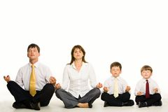 Meditating family Royalty Free Stock Image