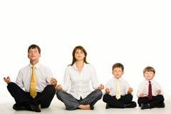 Meditating family royalty free stock image