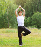 Meditating, fitness, yoga - concept, man doing exercise Stock Photos