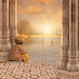 Meditating on the Ganges. Royalty Free Stock Image