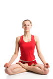 Meditating girl in yoga pose. A pretty blond girl in red underwear meditating in yoga pose Stock Photography