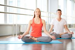 Meditating in gym Royalty Free Stock Photos