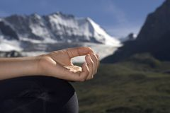 Meditating hand stock images