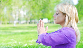 Meditating with hands joined Stock Image