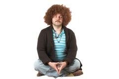 Meditating hippie. Hippie meditating royalty free stock photo