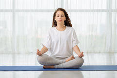 Meditating at home Stock Images