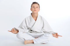 Meditating karate boy Stock Photo
