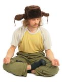 Meditating long-haired Russian man in cap with ear. Flaps on white Royalty Free Stock Photography