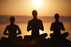 Meditating in lotus position Royalty Free Stock Photo