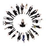 Meditating man. Circle of real people with a man meditating in the middle Stock Photography