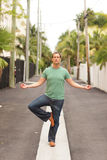 Meditating man. Man meditating in the middle of the road Royalty Free Stock Photos