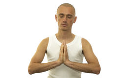Meditating Man. A meditating man sitting with his hands against each other royalty free stock image