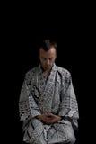 Meditating man. Isolated on black Stock Photos