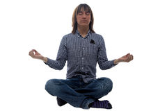 Meditating man on the floor Stock Photo
