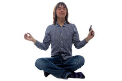 Meditating man with the gun Royalty Free Stock Image