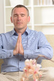 Meditating man Stock Images