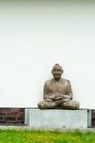 Meditating man. An old sculpture of meditating man Royalty Free Stock Images