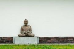 Meditating man. An old sculpture of meditating man Stock Photo