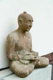 Meditating man. An old sculpture of meditating man Stock Image