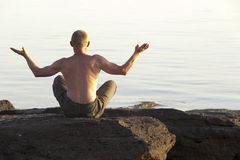 The meditating man on the seashore Stock Photography