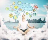 Meditating man thinking about life. Meditating man on clouds thinking about life. Waterfront city background Stock Photo