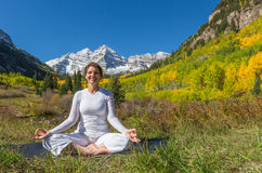 Meditating by Maroon Bells in Fall Stock Photography