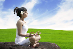 Meditating by the meadow Royalty Free Stock Photo