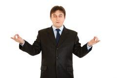 Meditating modern business woman Stock Image