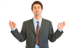 Meditating modern businessman with closed eyes Royalty Free Stock Image