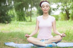 Meditating outdoors Royalty Free Stock Images