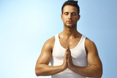 Meditating outdoors Stock Photo