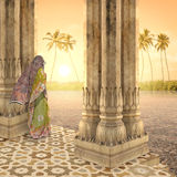 Meditating in the paradise. Indian woman meditating in the paradise during the sunset Stock Images