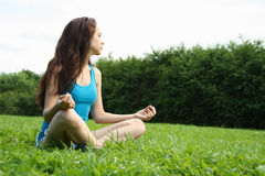 Meditating in the park Stock Image