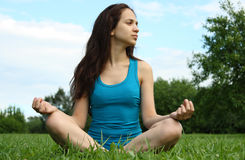 Meditating in the park Royalty Free Stock Photography