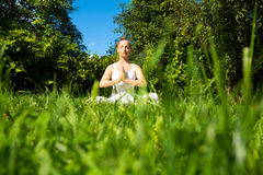 Meditating in the Park Royalty Free Stock Photos