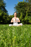 Meditating in the Park Royalty Free Stock Photo