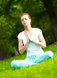 Meditating in park Royalty Free Stock Images