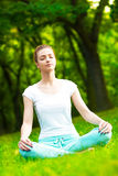 Meditating in park Stock Image