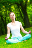 Meditating in park Stock Photo
