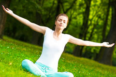 Meditating in park Stock Photography
