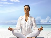 Meditating in peace on the coast Stock Photos